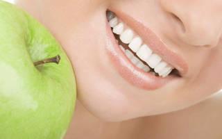 Зубы и яблоко